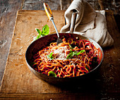 Spaghetti with tomato sauce in a pan