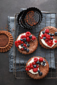 Chocolate cake topped with fresh berries