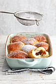 Rohrnudeln (baked, sweet yeast dumplings) with damson purée