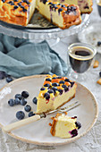 A piece of cheesecake with blueberries on a plate
