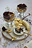 Banana dessert with brownie in glass bowls