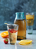 iced tea, cold brewed, orange, strawberries