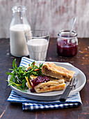 Oven baked pancake with lingonberry jam and salad