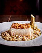 Cod in a beer sauce with spelt and mushrooms