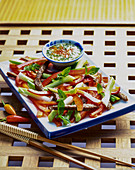 Pepper salad with spring onions and beef (Asia)
