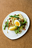 Gado gado with tofu, peanuts and boiled eggs