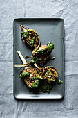 Grilled young artichokes with a parsley and mint pesto
