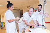 Three nurses in a hospital corridor