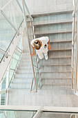 Nurse walking down the stairwell of a hospital