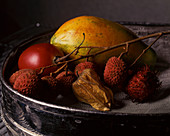 Exotic fruit in an old colander