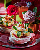Meringue nests with fruit and mint