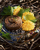 Tournedos with sweetcorn fritters and vine leaves