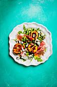 Grilled peach and gorgonzola salad with raw ham