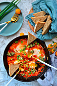 Shakshouka with spring onions