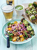 Grilled mushroom tofu skewers with pesto and wheat salad with tomatoes, walnuts and red onions