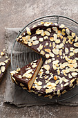 A chestnut cake with chocolate ganache and flaked almonds