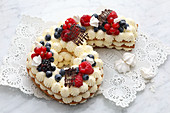 A number cake with cream and fresh berries