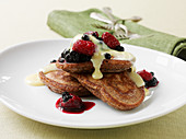 Pancakes with vanilla sauce and berries