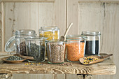 Different types of lentils in mason jars