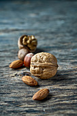 Walnuts, hazelnuts and almonds on a wooden surface
