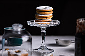 Linzer cookies placed on mini cake stand