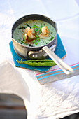 Turkish pea and mint soup with prawns