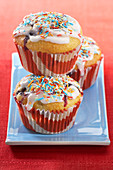Blueberry muffins with colourful sugar sprinkles