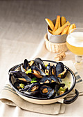 Mussels in a beer broth with chips