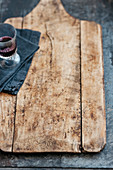 A glass of red wine on a blue linen napkin