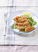 Fried red mullet fillets in an oat and almond coating