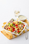 Chicken and pasta salad with aubergines and curry sauce