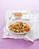 Fusilli with chicken, date tomatoes and fennel leaves
