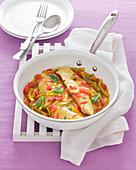 Saffron cod fillet with vegetable sauce