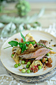 Pink roasted lamb fillet with artichoke and pea ragout (Turkey)