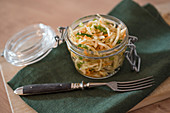 White cabbage salad with carrots, spring onions and dill