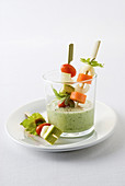 Cucumber and yoghurt dipping sauce with vegetables skewers
