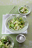 A green salad with radishes and cucumber