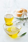 Olive oil in a bowl and in a carafe