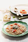 Cherry tomato risotto with caper pesto