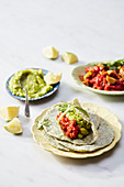 Spinach tortillas with guacamole, tomato sauce and tempeh