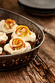 Muffins with topping and apple roses