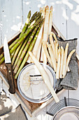 Green and white asparagus with a peeler