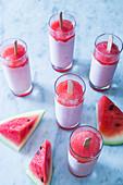 Watermelon yoghurt ice popsicles in glasses