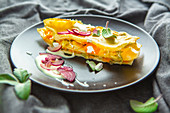 Pointed cabbage and carrot lasagna with sour cream dip