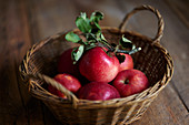 Fresh red apples in a wicker basket