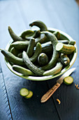 Fresh small snake cucumbers in a bowl