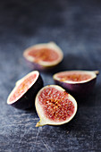 Fig halves on a gray background