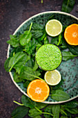 Green smoothie made of spinach and citrus