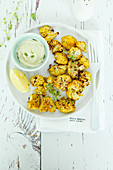 Roasted spiced cauliflower with yogurt sauce