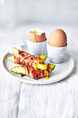 Soft-boiled eggs with pancetta avocado soldiers
